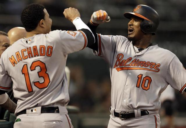 "<a class=""link rapid-noclick-resp"" href=""/mlb/players/9111/"" data-ylk=""slk:Manny Machado"">Manny Machado</a> (left) and <a class=""link rapid-noclick-resp"" href=""/mlb/players/7812/"" data-ylk=""slk:Adam Jones"">Adam Jones</a> (right) celebrate during less complicated times for the Orioles. (AP)"