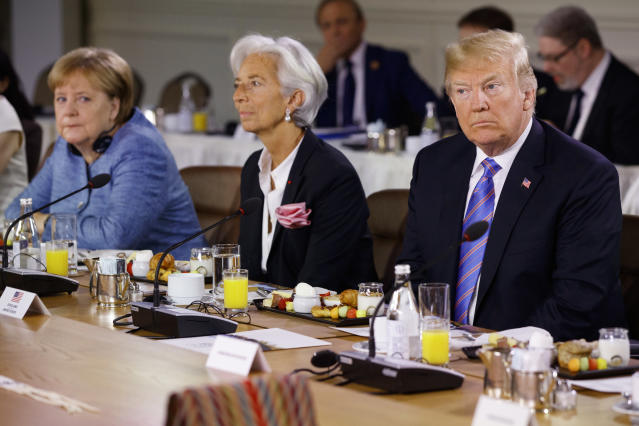 <p>President Donald Trump listens during the Gender Equality Advisory Council breakfast during the G-7 summit, Saturday, June 9, 2018, in La Malbaie, Quebec, Canada. From left, German Chancellor Angela Merkel, IMF Managing Director Christine Lagarde, and Trump. (Photo: Evan Vucci/AP) </p>