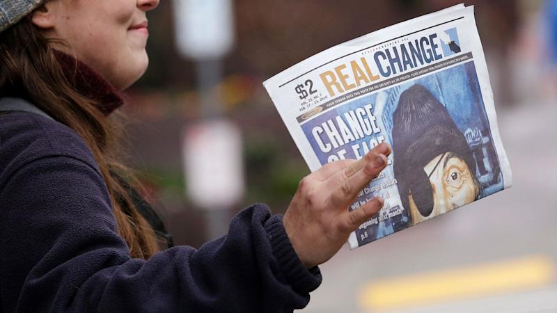 The street newspaper Real Change is written by a paid staff and sold by self-employed vendors, many of whom are homeless. (Photo: Elaine Thompson/AP)