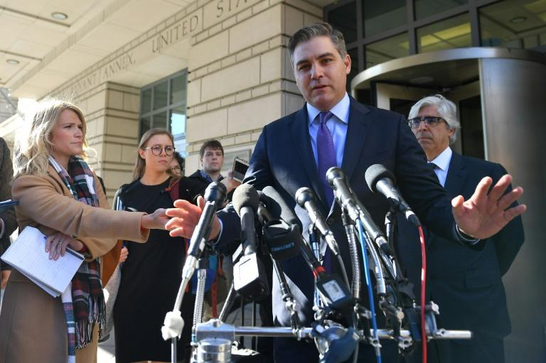 CNN White House correspondent Jim Acosta speaks outside the US District Court in Washington after a judge ordered his press credentials temporarily restored