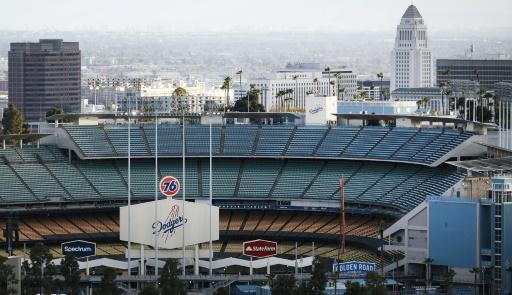An empty Dodger Stadium awaits Major League Baseball and its players union to make a deal on a new season