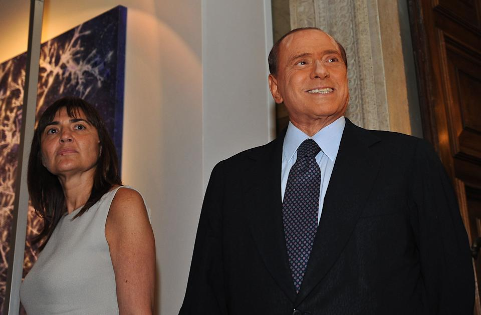 Italian Prime Minister Silvio Berlusconi looks on next to the President of the Lazio region Renata Polverini as he visits an exhibition at the Palazzo Venezia in Rome on June 24, 2011.  AFP PHOTO / ANDREAS SOLARO (Photo credit should read ANDREAS SOLARO/AFP via Getty Images) (Photo: ANDREAS SOLARO via Getty Images)