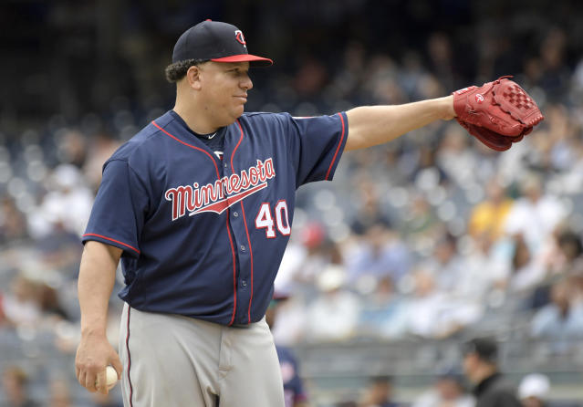 Bartolo Colon has obviously been practicing his pigeon-feeding technique for years. (AP Photo)