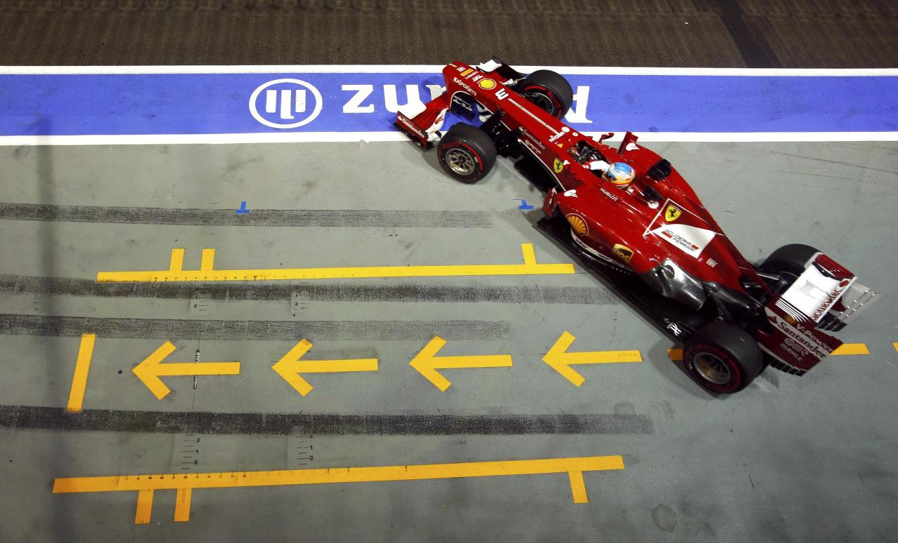 Ferrari Formula One driver Fernando Alonso of Spain drives during the qualifying session of the Singapore F1 Grand Prix at the Marina Bay street circuit in Singapore September 21, 2013. REUTERS/Edgar Su (SINGAPORE - Tags: SPORT MOTORSPORT F1)