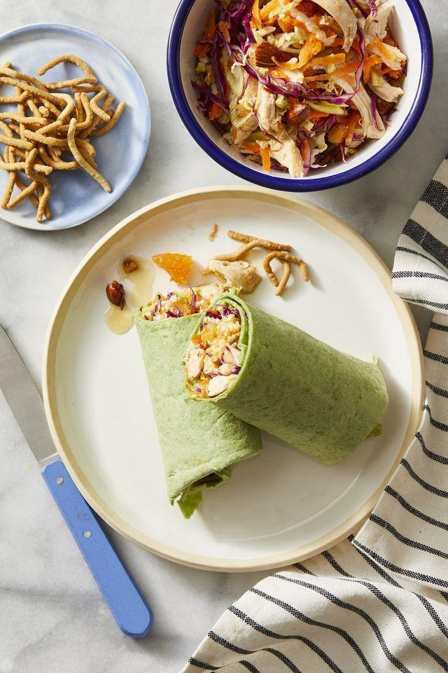 """<p>Sweet and slightly tangy, these <a href=""""https://www.goodhousekeeping.com/food-recipes/easy/g28136655/best-wrap-recipes/"""" rel=""""nofollow noopener"""" target=""""_blank"""" data-ylk=""""slk:chicken salad wraps"""" class=""""link rapid-noclick-resp"""">chicken salad wraps</a> get a hit of crunch from roasted almonds and crispy chow mein noodles. <em>Yum!</em> </p><p><em><a href=""""https://www.goodhousekeeping.com/food-recipes/a28223667/chinese-chicken-salad-wraps-recipe/"""" rel=""""nofollow noopener"""" target=""""_blank"""" data-ylk=""""slk:Get the recipe for Chinese Chicken Salad Wraps »"""" class=""""link rapid-noclick-resp"""">Get the recipe for Chinese Chicken Salad Wraps »</a></em></p>"""