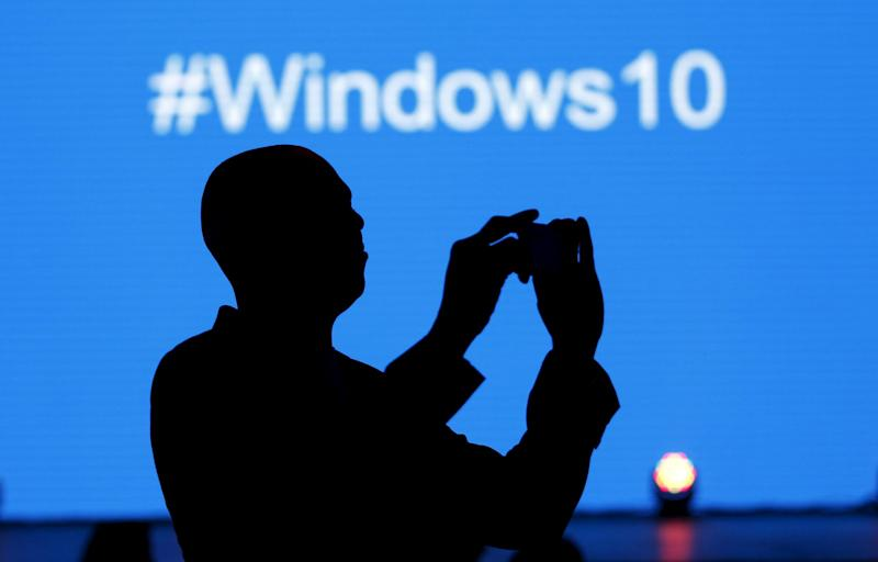 A Microsoft delegate takes a picture during the launch of the Windows 10 operating system in Kenya's capital Nairobi, July 29, 2015: REUTERS/Thomas Mukoya