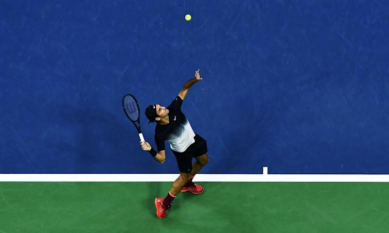 Switzerland's Roger Federer serves the ball to Spain's Feliciano Lopez during their 2017 US Open Men's Singles match.