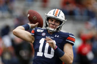 Auburn quarterback Bo Nix (10) warms up before the first half of an NCAA college football game against Samford, Saturday, Nov. 23, 2019, in Auburn, Ala. (AP Photo/Butch Dill)