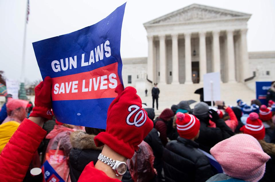 Supporters of gun control and firearm safety measures hold a protest rally outside the US Supreme Court as the Court hears oral arguments in State Rifle and Pistol v. City of New York, NY, in Washington, DC, December 2, 2019.