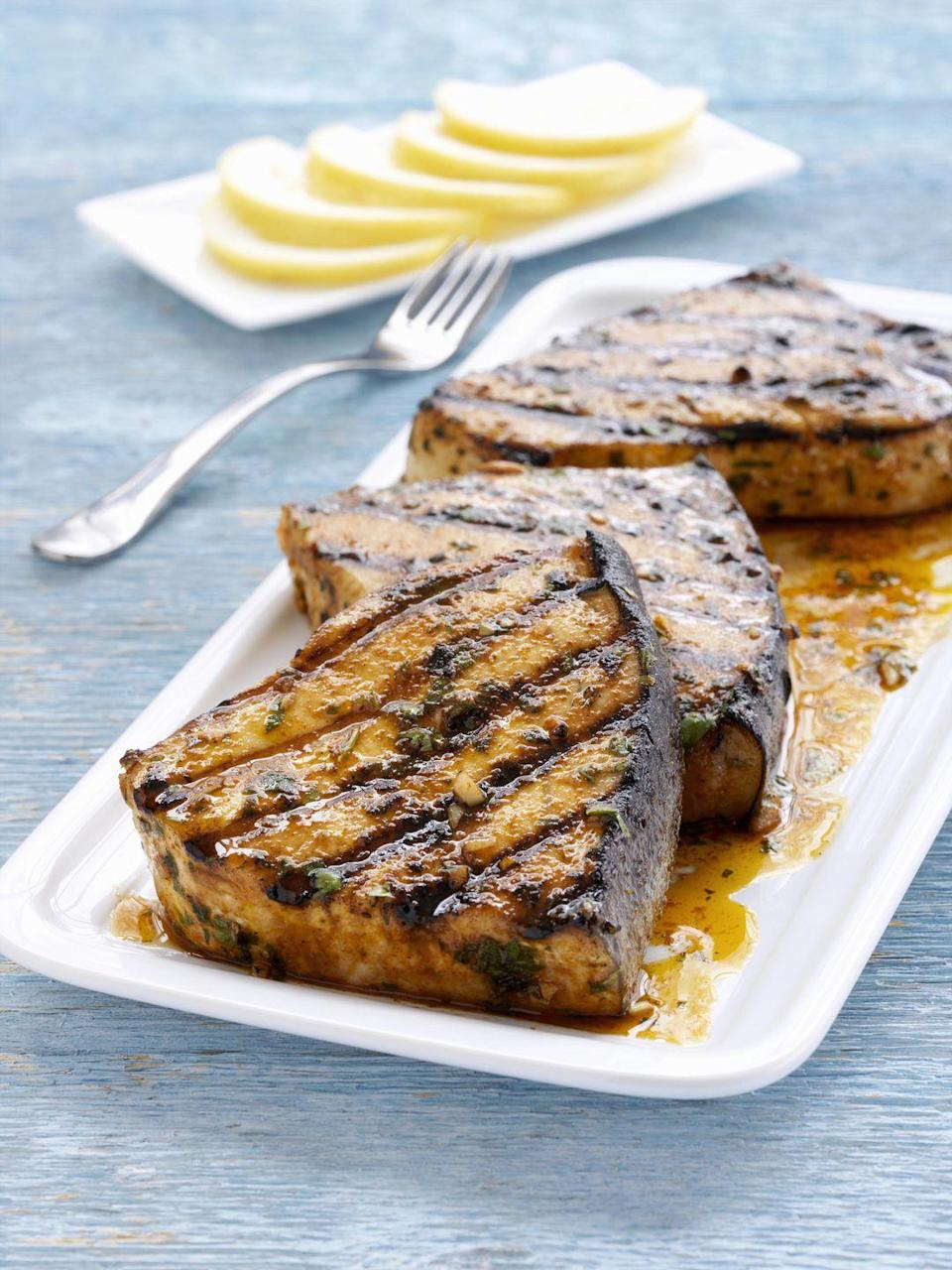 """<p>If you're a meat lover who's trying to add more fish to your diet, look no further. Available both fresh and frozen, this low-calorie billfish (3 ounces contains approximately 146 calories and 566 IU of vitamin D) is actually referred to as steak for its meaty texture. Plus, swordfish has a mild, sweet flavor, takes only minutes to cook (usually less than 10 minutes), and is quite versatile since it can be grilled, baked, broiled, and pan-roasted. (Just make sure to eat sparingly, as <a href=""""https://www.nrdc.org/stories/mercury-guide"""" rel=""""nofollow noopener"""" target=""""_blank"""" data-ylk=""""slk:swordfish contains high levels of mercury"""" class=""""link rapid-noclick-resp"""">swordfish contains high levels of mercury</a>.)</p>"""