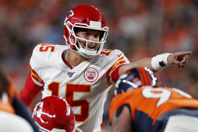 Kansas City Chiefs quarterback Patrick Mahomes (15) makes a call during the first half of an NFL football game against the Denver Broncos, Thursday, Oct. 17, 2019, in Denver. (AP Photo/David Zalubowski)