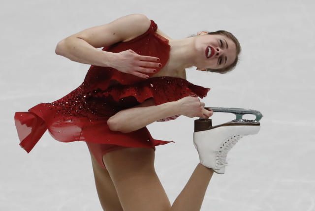 Italy's Carolina Kostner performs during women's short program at the Figure Skating World Championships in Assago, near Milan, Wednesday, March 21, 2018. (AP Photo/Antonio Calanni)