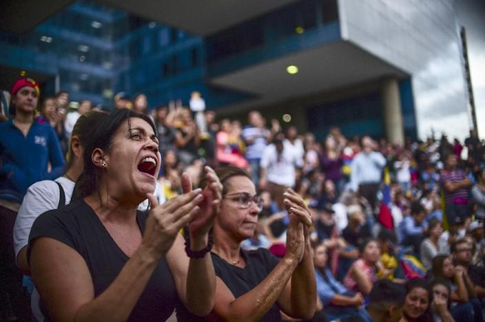 Venezuelans, who protested against President Nicolas Maduro in Caracas on Monday after the controversial vote, are planning to be back in the streets on Friday (AFP Photo/RONALDO SCHEMIDT)