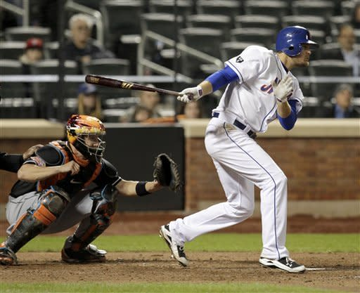 New York Mets' Lucas Duda singles to drive in a run during the eighth inning of the baseball game against the Miami Marlins on Tuesday, April 24, 2012, at Citi Field in New York. (AP Photo/Seth Wenig)