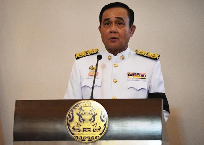 Former army chief Prayut Chan-O-Cha led the 2014 coup to remove the democratically elected government and is now transforming himself into a civilian political leader (AFP Photo/Lillian SUWANRUMPHA)