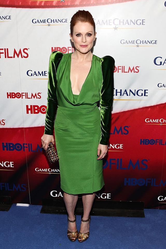 "And last but not least we have the beloved Julianne Moore, who bombed on the blue carpet at the Washington, D.C. premiere of ""Game Change."" We can't wait to see <a target=""_blank"" href=""http://tv.yahoo.com/news/how-julianne-moore-became-sarah-palin-for-hbo-s--game-change-.html"">Moore play Sarah Palin</a> in the HBO film -- premiering this Saturday night -- nor can we wait for her to burn this leprechaun-like Tom Ford dress, which featured unsightly velvet sleeves and an unflattering cowl neck. (3/8/2012)<br><br><a href=""http://bit.ly/lifeontheMlist"">Follow What Were They Thinking?! creator, Matt Whitfield, on Twitter!</a>"