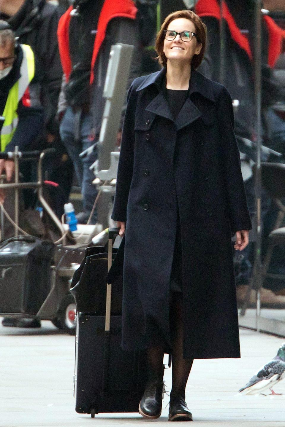 <p>Michelle Dockery has her eyes on the sky on Saturday while filming <em>Anatomy of a Scandal</em> in London.</p>
