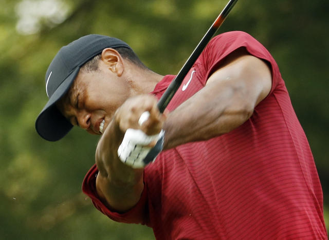 Tiger Woods hits from the 15th tee during the final round of the PGA Championship golf tournament at Bellerive Country Club, Sunday, Aug. 12, 2018, in St. Louis. (AP Photo/Charlie Riedel)