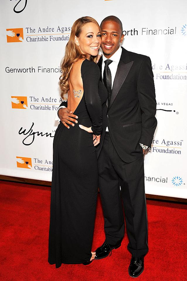 "Newlyweds Mariah Carey and Nick Cannon attend the 13th Annual Andre Agassi Charitable Foundation's Grand Slam for Children benefit concert at the Wynn hotel and casino in Las Vegas. Denise Truscello/<a href=""http://www.wireimage.com"" target=""new"">WireImage.com</a> - October 11, 2008"