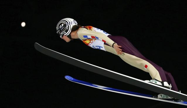 France's Mattel soars through the air during the women's ski jumping individual normal hill event of the Sochi 2014 Winter Olympic Games in Rosa Khutor