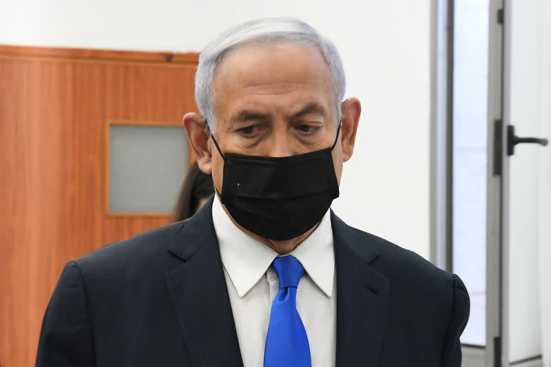Israeli Prime Minister Benjamin Netanyahu looks on as he arrives to a hearing in his corruption trial at Jerusalem's District Court
