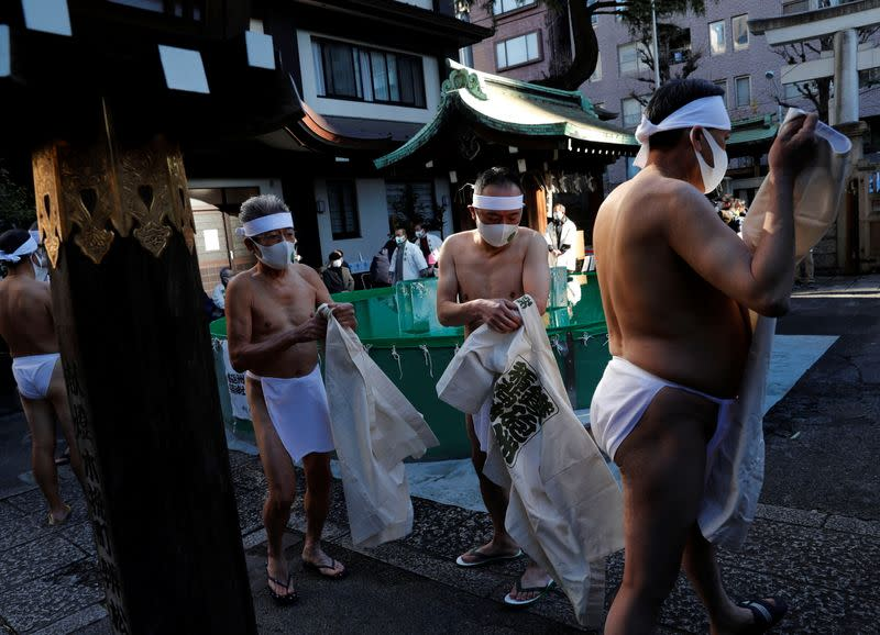 Participants wearing protective masks, amid the coronavirus disease (COVID-19) outbreak, take an ice-cold bath at a ceremony in Tokyo