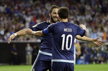 Jun 21, 2016; Houston, TX, USA; Argentina forward Gonzalo Higuain (left) celebrates with midfielder Lionel Messi (10) after scoring a goal during the second half against the United States in the semifinals of the 2016 Copa America Centenario soccer tournament at NRG Stadium. Mandatory Credit: Kevin Jairaj-USA TODAY Sports