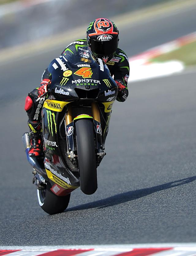 Monster Yamaha Tech 3's Italian rider Andrea Dovizioso rides past at the Catalunya racetrack in Montmelo, near Barcelona, on June 2, 2012, during the MotoGP third training session of the Catalunya Moto GP Grand Prix. AFP PHOTO/LLUIS GENELLUIS GENE/AFP/GettyImages