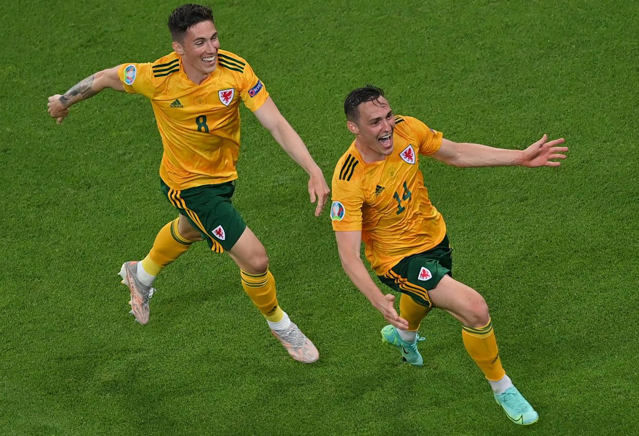 Connor Roberts (R) celebrates scoring his team's first goal with midfielder Harry Wilson.
