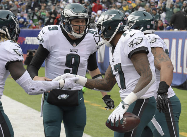 Eagles quarterback Nick Foles tossed an impressive four touchdowns while leading a 13-point comeback win over the Giants in Week 15. (AP Photo/Bill Kostroun)