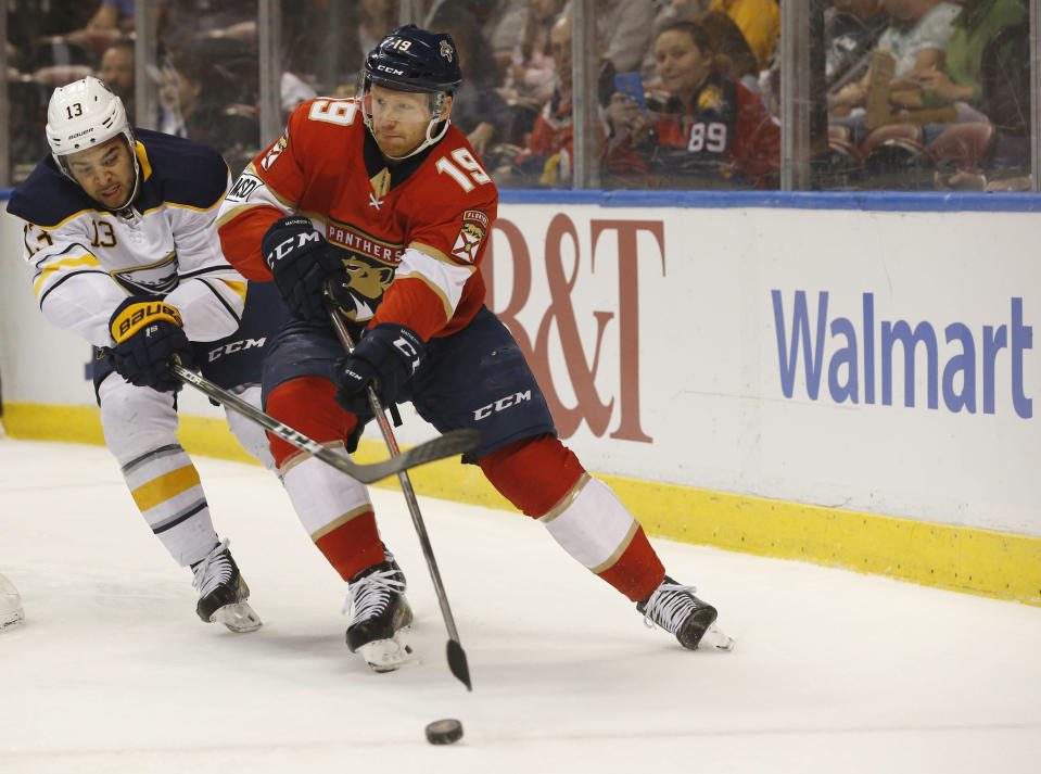Florida Panthers defenseman Mike Matheson (19) and Buffalo Sabres right wing Nicholas Baptiste (13) battle for the puck during the first period of an NHL hockey game, Friday, March 2, 2018, in Sunrise, Fla. (AP Photo/Wilfredo Lee)