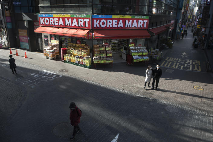 People walk in Central Seoul, South Korea, on March 19, 2020. (Woohae Cho/The New York Times).