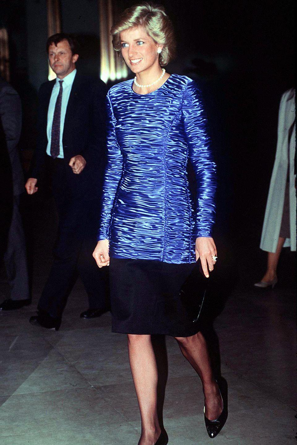 <p>The princess wears a ruched blue and black evening dress while out in New York. </p>