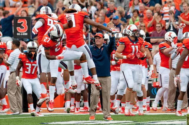 Illinois players celebrate after a fumble recovery during the first quarter of an NCAA college football game against Western Kentucky, Saturday, Sept. 6, 2014, at Memorial Stadium in Champaign, Ill. (AP Photo/Bradley Leeb)