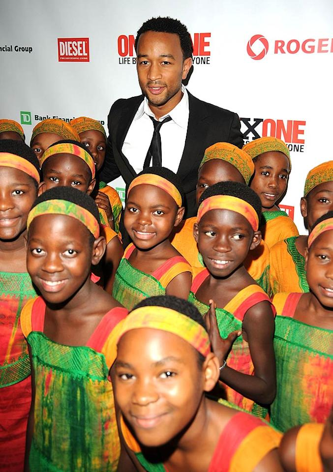 """The African Children's Choir meets one of their musical inspirations: John Legend. George Pimentel/<a href=""""http://www.wireimage.com"""" target=""""new"""">WireImage.com</a> - September 8, 2008"""