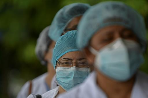 Health workers protest for lack of medical supplies at the Dr Arnulfo Arias Madrid hospital complex in Panama City, on July 16, 2020, as Panama exceeds 50,000 cases of COVID-19