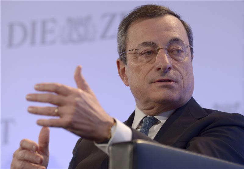 """ECB President Draghi gestures during his speech at the """"German Economic Forum"""" in the St.Michaelis church in Hamburg"""