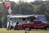 A camper displays Confederate Battle flag in a campground across from the Speedway during the NASCAR Xfinity auto race at the Talladega Superspeedway in Talladega Ala., Saturday June 20, 2020 (AP Photo/John Bazemore)