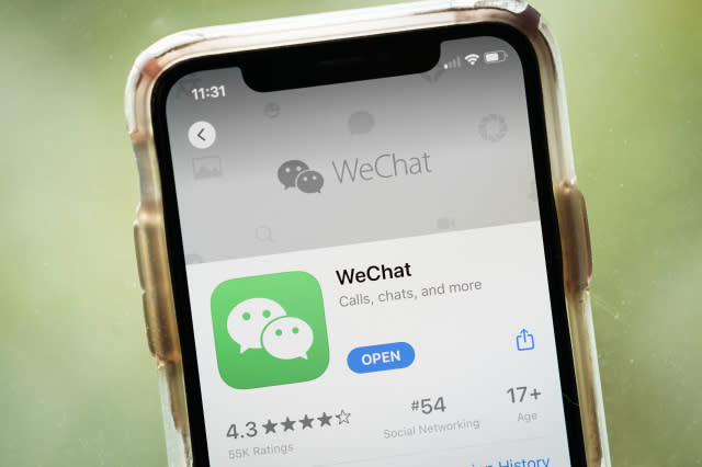 WASHINGTON, DC - AUGUST 07: In this photo illustration, the WeChat app is displayed in the App Store on an Apple iPhone on August 7, 2020 in Washington, DC. On Thursday evening, President Donald Trump signed an executive order that bans any transactions between the parent company of TikTok, ByteDance, and U.S. citizens due to national security reasons. The president signed a separate executive order banning transactions with China-based tech company Tencent, which owns the app WeChat. Both orders are set to take effect in 45 days. (Photo Illustration by Drew Angerer/Getty Images)