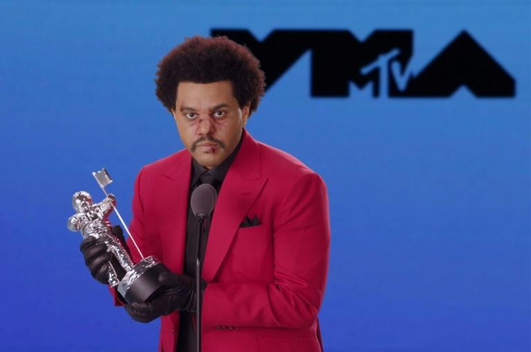"""Canadian singer-songwriter The Weeknd, shown here accepting the VMA award for Video of the Year for """"Blinding Lights,"""" was curiously left out of this year's Grammy race"""