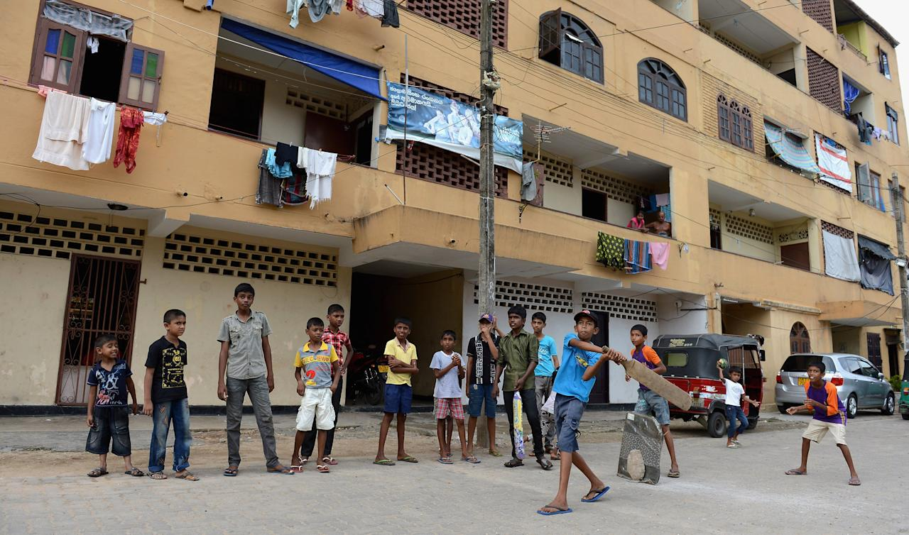 COLOMBO, SRI LANKA - SEPTEMBER 22:  Local children play cricket on the streets outside the R. Premadasa Stadium during the ICC World Twenty20 2012 Group B match between Australia and the West Indies on September 22, 2012 in Colombo, Sri Lanka.  (Photo by Gareth Copley/Getty Images)