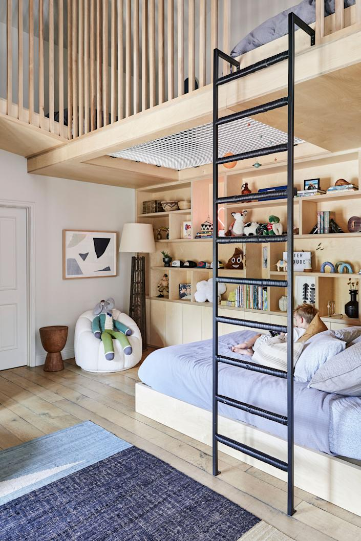 """<div class=""""caption""""> When she was pregnant with Banks, Duff decided to transform a large guest room she had rarely used into a bedroom for her older son, Luca. """"The room is so tall, and so we made the most of all of it,"""" says Duff. The lofted space features two single bunk beds with a sturdy climbing net between them. """"As a family, we have really been into <em>American Ninja Warrior</em>, and Luca loves for me to give him these fun, timed challenges. Climb up the ladder, climb down the ladder…"""" explains Duff. """"It also helps him burn <em>a lot</em> of energy."""" </div>"""