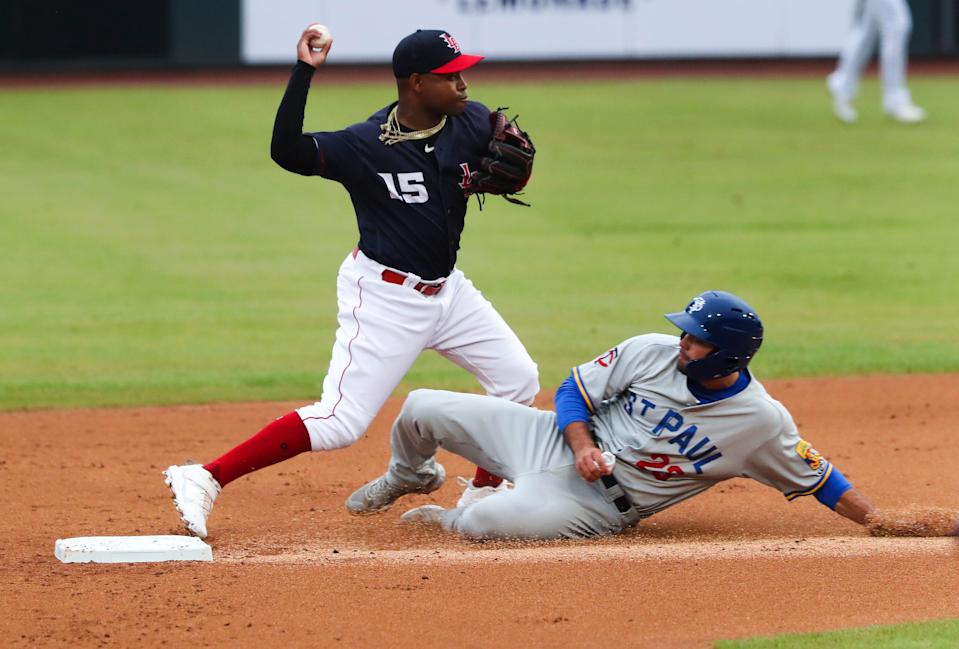 The Louisville Bats Alfredo Rodriguez (15) threw to first to complete the double play after forcing out St. Paul Saints Damek Tomscha (23) at second during their game at Slugger Field in Louisville, Ky. on June 2, 2021.