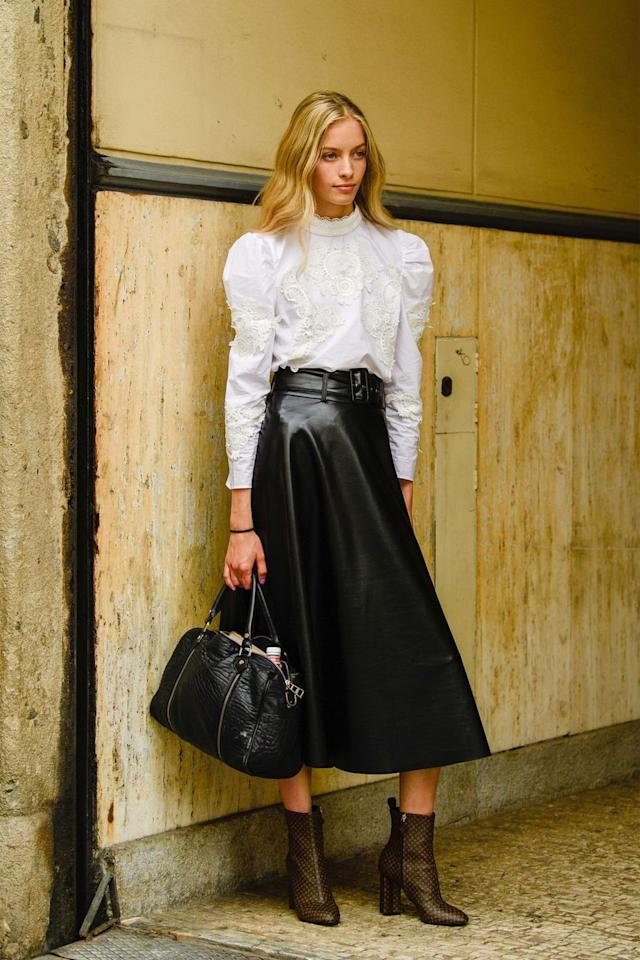 """<p>This season, add a leather midi skirt to your 9-to-5 wardrobe. It'll prove to be a versatile statement piece for the office, working with everything from classic white blouses to blazers and beyond. </p><p><strong>Get the look: Rebecca Taylor </strong>vegan leather skirt, $425, <a href=""""https://www.rebeccataylor.com/vegan-leather-skirt/519413S924.html"""" target=""""_blank"""">rebeccataylor.com</a>.</p><p><a class=""""body-btn-link"""" href=""""https://go.redirectingat.com?id=74968X1596630&url=https%3A%2F%2Fwww.rebeccataylor.com%2Fvegan-leather-skirt%2F519413S924.html&sref=http%3A%2F%2Fwww.harpersbazaar.com%2Ffashion%2Fstreet-style%2Fg6768%2Fwinter-office-outfit-ideas%2F"""" target=""""_blank"""">SHOP NOW </a></p>"""