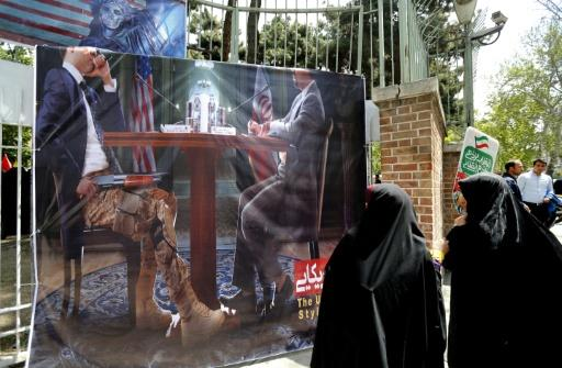 Iranians take part in an anti-US demonstration inside the former embassy headquarters in Tehran on May 16, 2018