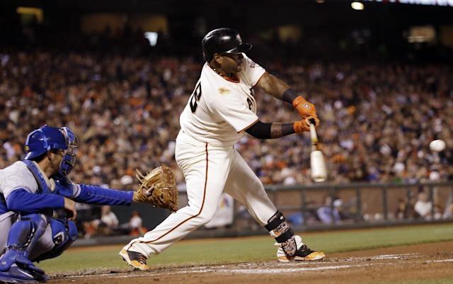 San Francisco Giants' Pablo Sandoval singles against the Los Angeles Dodgers during the third inning of a baseball game Wednesday, April 16, 2014, in San Francisco. (AP Photo/Marcio Jose Sanchez)