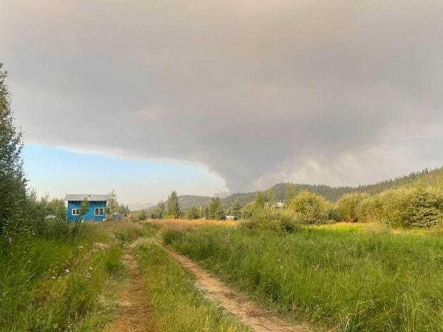 Smoke from the Coal Creek wildfire is visible from Rian Lougheed Smith's property near Rock Creek. Smith and other local property owners are under an evacuation alert. (Rian Lougheed Smith - image credit)