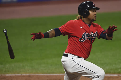 Cleveland Indians' Jose Ramirez watches his two-run double during the fifth inning of Game 2 of the team's American League wild-card baseball series against the New York Yankees, Wednesday, Sept. 30, 2020, in Cleveland. (AP Photo/David Dermer)