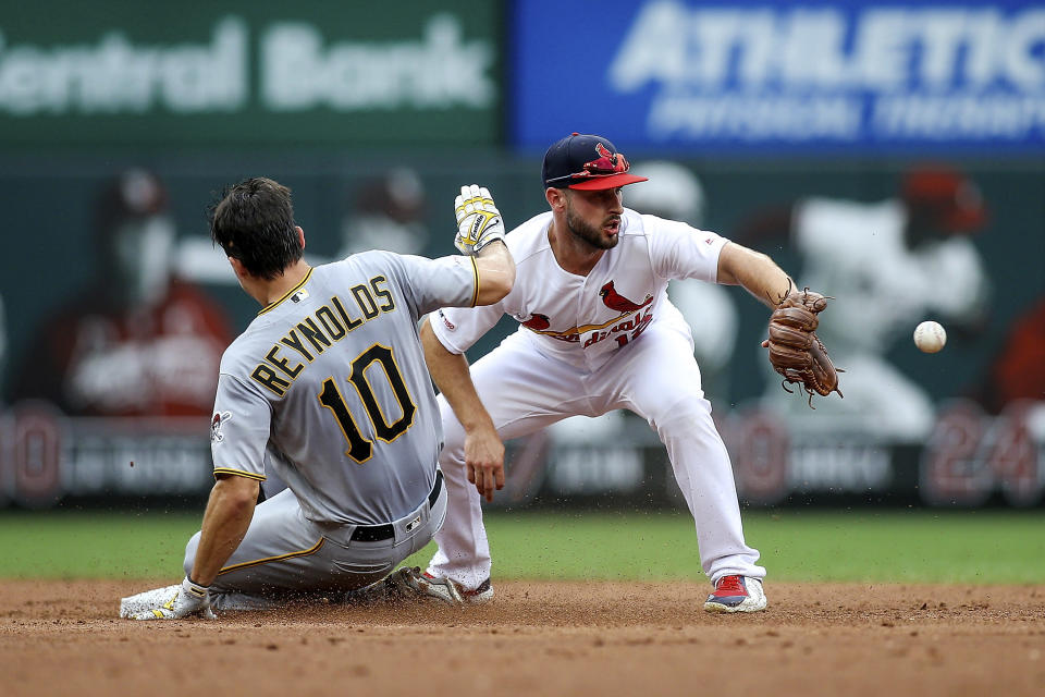 Pittsburgh Pirates' Bryan Reynolds, left, slides safely into second base as St. Louis Cardinals shortstop Paul DeJong, right, waits for the ball during the third inning of a baseball game Sunday, Aug. 11, 2019, in St. Louis. (AP Photo/Scott Kane)
