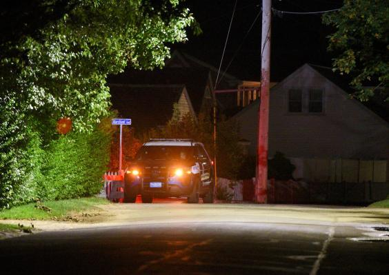 A Barnstable Police cruiser sits at the top of Marchant Avenue as police investigate Saoirse Kennedy Hill's death (REUTERS)